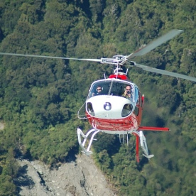 Helicopter flying into Fox Glacier
