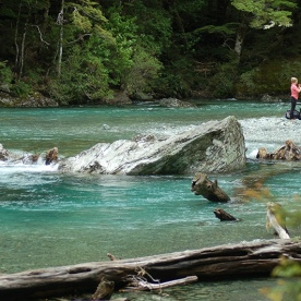 Hikers relaxing by the Routeburn River