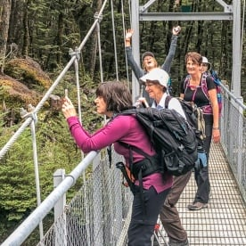 Ladies on Routeburn Track River Bridge, Otago New Zealand