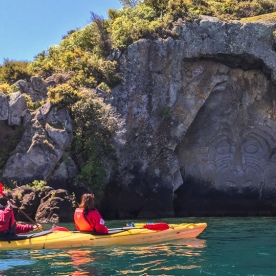 Kayaking close to Maori carvings at lake Taupo, Waikato New Zealand