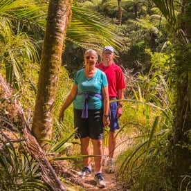 Couple at Porarari river, Paparoa National Park West Coast New Zealand