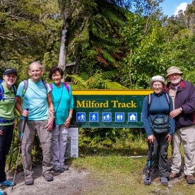 Group at Milford Track, Arthur river, Fiordland New Zealand