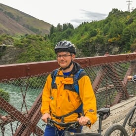 Couple biking on Kawarau river bridge, Otago New Zealand