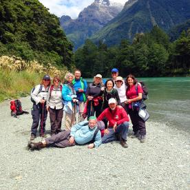 hiking group on the hollyford track new zealand
