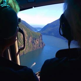 view from helicopter at milford sound new zealand