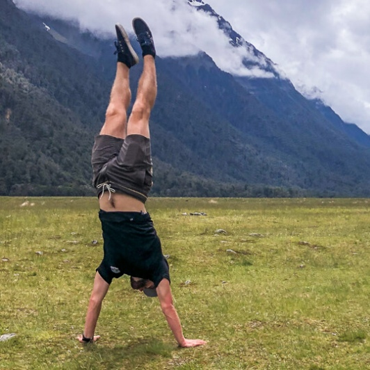 Headstand at Eglinton Valley, Fiordland New Zealand