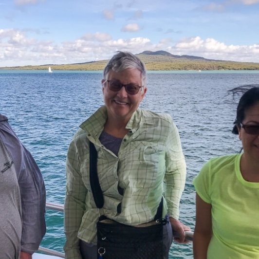 Group on the boat with Rangitoto Island in the background, Auckland New Zealand