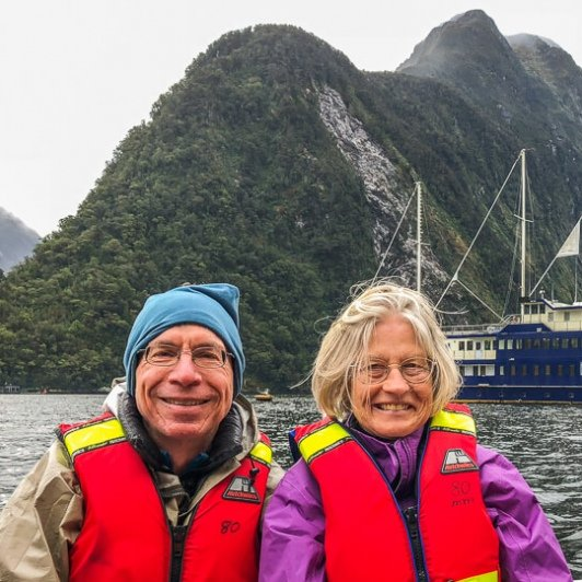 Couple on the boat at Milford Sound, Fiordland New Zealand
