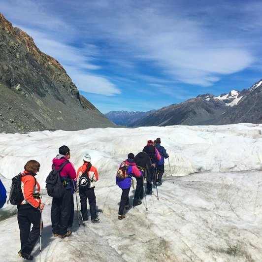 Crampons on and follow the leader across the impressive Tasman Glacier.