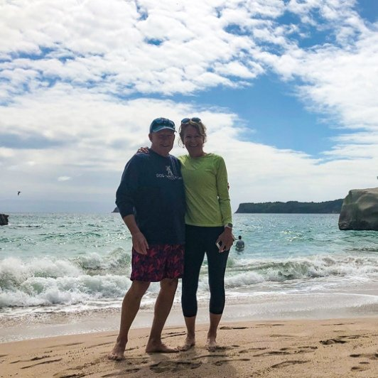Couple at Cathedral Cove beach