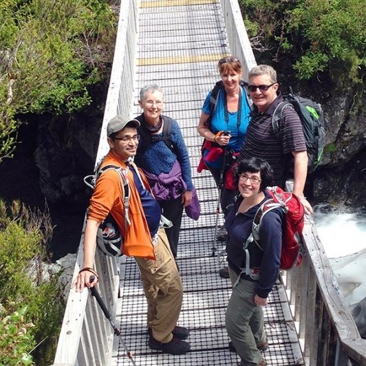 hikers at arthurs pass bridge new zealand