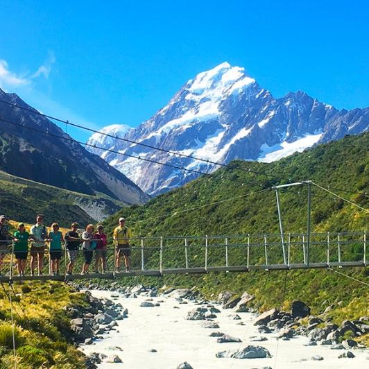 Aoraki/Mt Cook towers over our intrepid heritage walkers. Hooker Valley walk.
