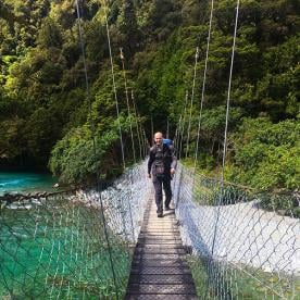 Crossing the gorgeous clear waters of the Hollyford Valley New Zealand