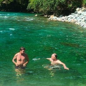 Colling off with a refreshing dip in a swimming hole. Hollyford Valley New Zealand