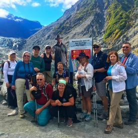 The team stops for a group shot at Fox Glacier