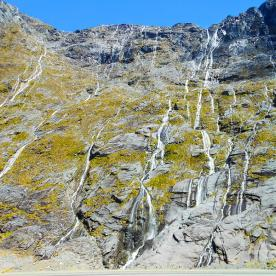 Incredible waterfalls on the sheer walls of the Homer Pass along the Milford Road
